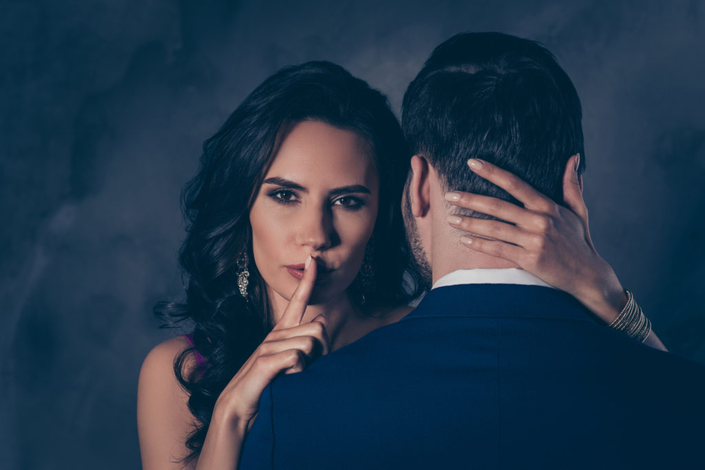 man and woman in secret relationship